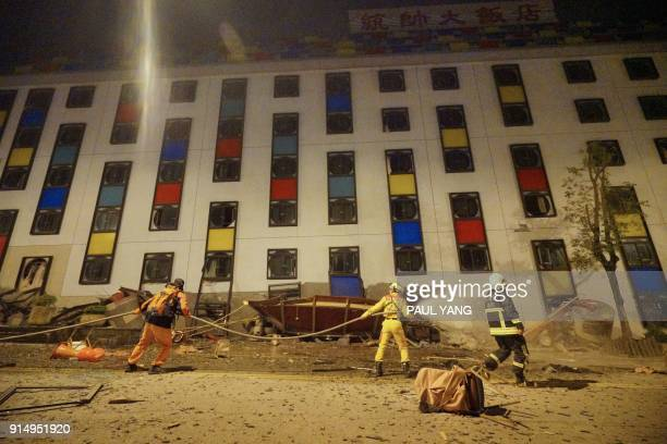 Rescure workers search the damaged Marshal Hotel in Hualien eastern Taiwan early February 7 after a strong earthquake struck the island A hotel on...