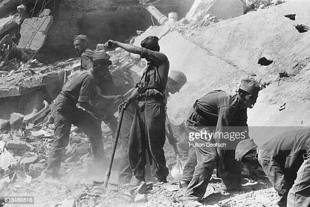 Rescus workers among the debris left by an earthquake in the city of Skopje in Yugoslavia, 1963.