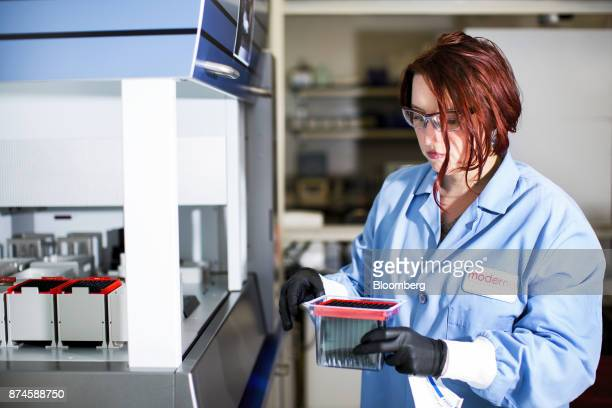 A research associate works at the Moderna Therapeutics Inc lab in Cambridge Massachusetts US on Tuesday Nov 14 2017 Moderna this week started testing...