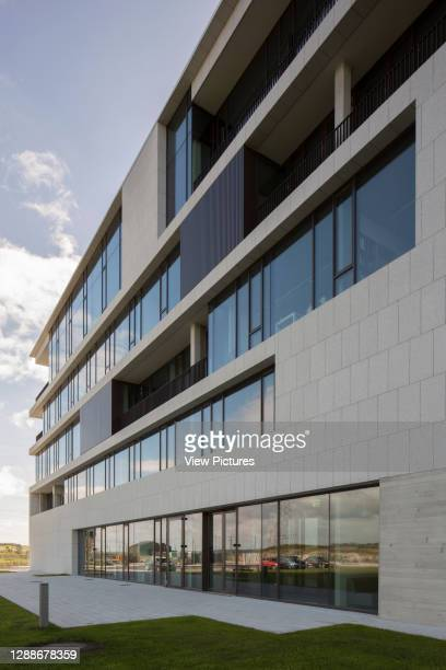 Research block with window glazing and canopied terrace voids. Beaufort Maritime and Energy Research Laboratory, Ringaskiddy, Ireland. Architect:...