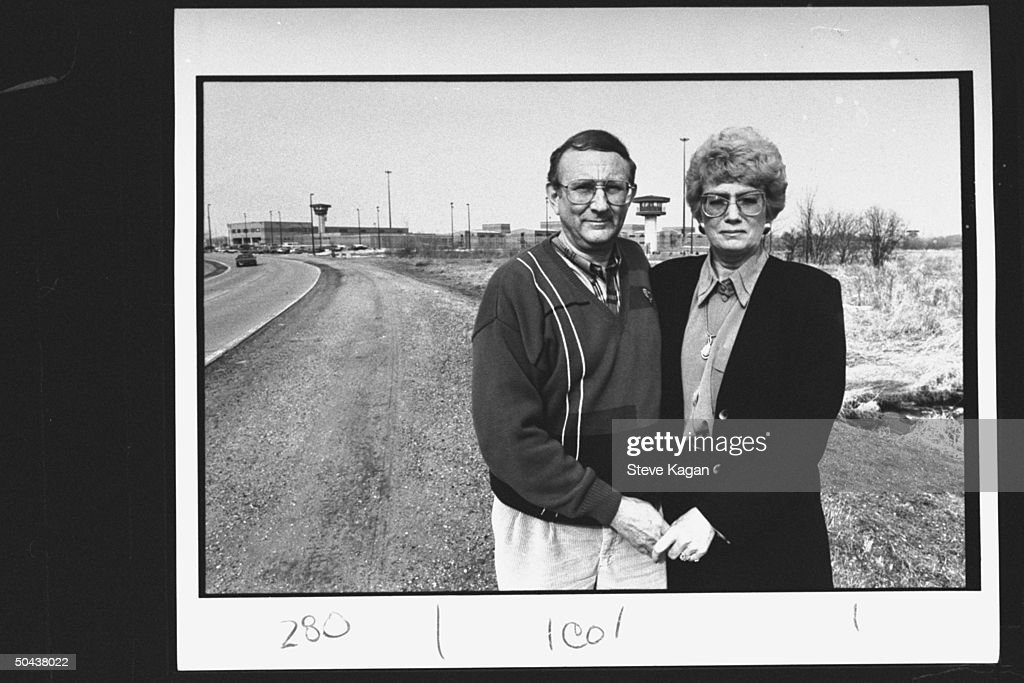 Research chemist/author Lionel Dahmer, father of confessed serial killer Jeffrey Dahmer, w. wife Shari (stepmother) standing outside of Columbia Correctional Institute where Jeffrey is imprisoned.