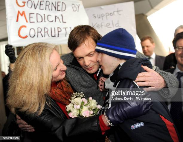 MMR research doctor Andrew Wakefield and wife Carmen Wakefield hug a child suffering from Autism after making a statement at the General Medical...
