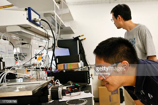 Research engineer Dan Guevarra right and staff scientist Cheng Xiang rear perform a CO2 reduction experiment developing solar fuels in the Joint...