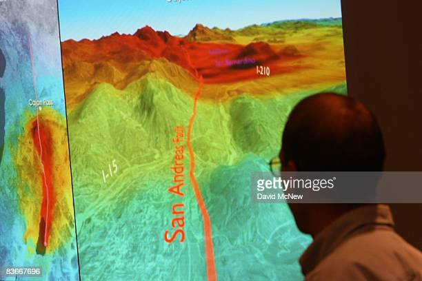 Research geophysicist with the United States Geological Survey Brad Aagaard shows members of the media a series of images that illustrate how shock...