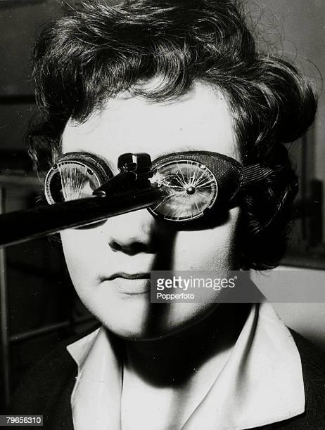 12th February 1963 This demonstration photographs shows a pair of safety goggles having only cracked despite being struck by a 6mm ball from a small...