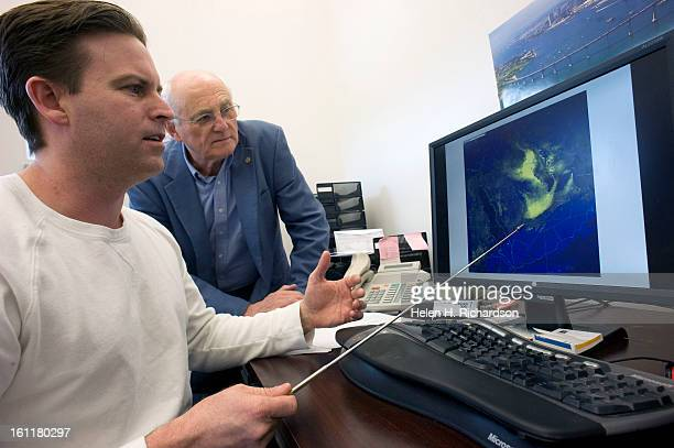 Research scientist Steven Miller PhD left and Professor Thomas Vonder Haar look at a dust storm raging in the the middle east through Iraq and Saudi...