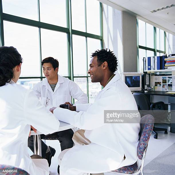 Research scientists in meeting in laboratory