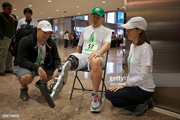 Research scientists Levi Hargrove and Annie Simon look on as Zac Vawter a 31yearold software engineer from Seattle Washington tests the worlds first...