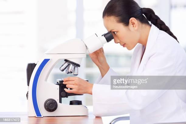 Researcher Analyzing Biopsy Samples.