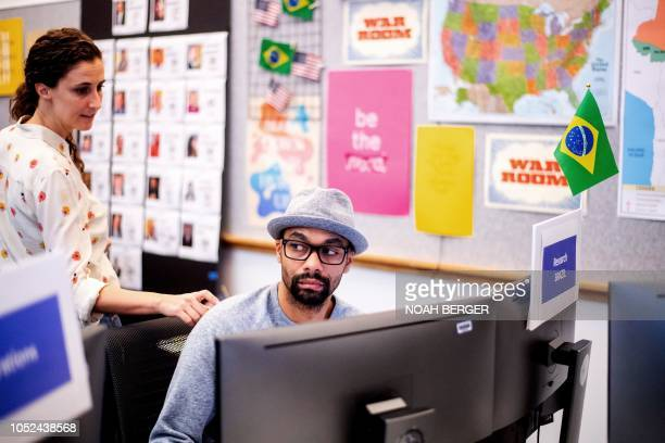 Researcher Andre Souza works in Facebook's War Room during a media demonstration on October 17 in Menlo Park California The freshly launched unit at...