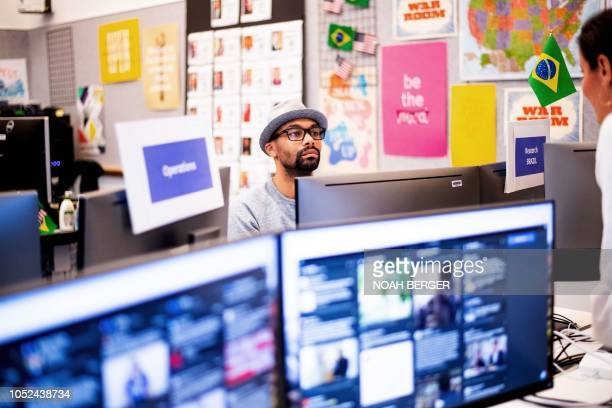"""Researcher Andre Souza works in Facebook's """"War Room,"""" during a media demonstration on October 17 in Menlo Park, California. - The freshly launched..."""