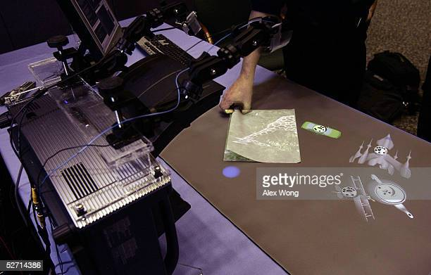 Researcher Andy Wilson of Microsoft Research demonstrates 'PlayAnywhere' during a Microsoft Tech Fair April 27 2005 at the Library of Congress in...