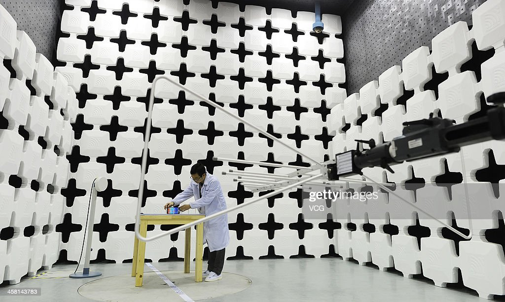 A researcher arranges a Lenovo smart phone during an electromagnetic compatibility (EMC) test at the Lenovo MIDH (Mobile Internet and Digital Home) Wuhan Operation Center on December 19, 2013 in Wuhan, China. The plant will mainly produce Lenovo smart phones and tablet computers with an initial capacity of 30 million units a year.