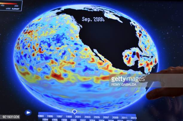 A researcher at the analysis centre of Mercator Oceans points at a screen images of ocean surveillance on December 7 2017 in Toulouse What is the...