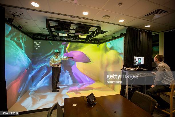 A researcher explores the inside of a human brain using threedimensional imagery in the Visbox Inc VisCube at the Pfizer Inc research and development...