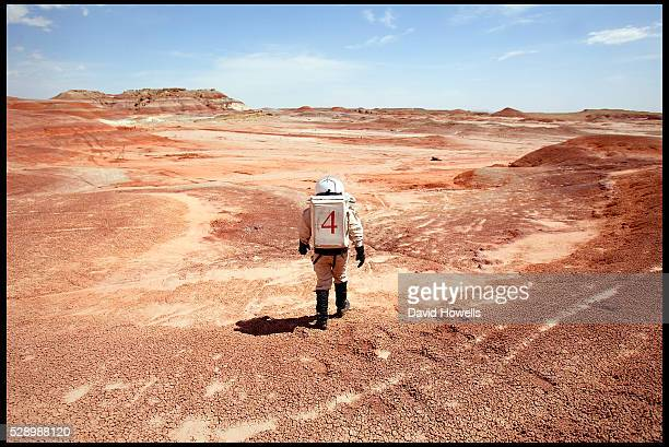 A researcher in a space suit on Mars at the Mars Society Desert Research Station Hanksville Utah The environment in the Utah desert where the...