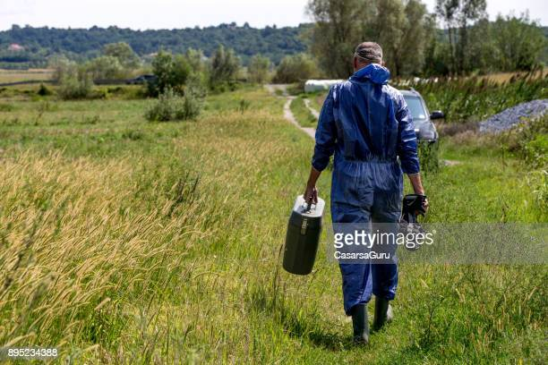 Researcher in Protective Workwear Leaving Research Site