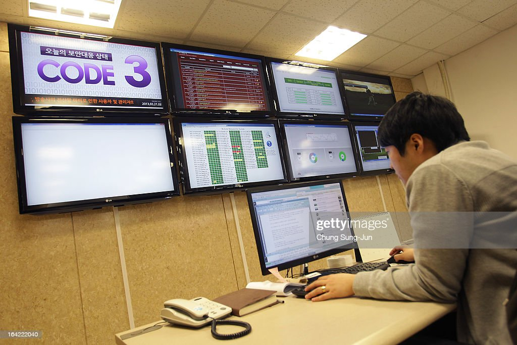 A researcher inspecting for computer viruses at Hauri Inc. the IT security software vendor on March 21, 2013 in Seoul, South Korea. A cyber attack on the computer networks that run three South Korean banks, two broadcasters and an internet service provider in South Korea yesterday has been traced to an IP address in China, despite many experts suspecting the attacks to originate in North Korea. Officials noted that while the attack was traced to an IP address it China may have originated elsewhere and been routed through the country to disguise the attackers.
