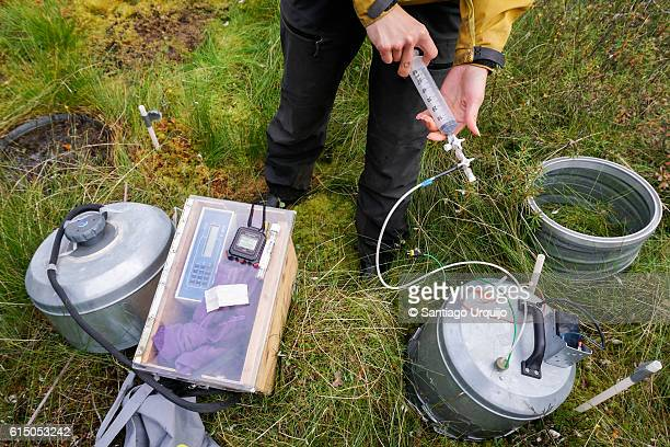 Researcher measuring methane and CO2 emissions from peatland