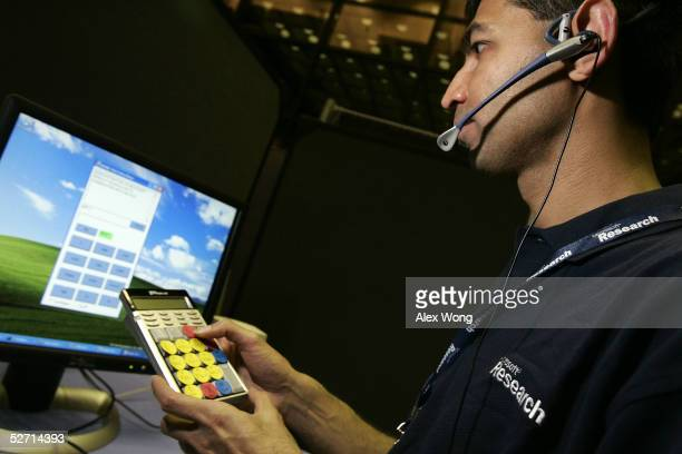 Researcher Milind Mahajan of Microsoft Research demonstrates 'Text Entry for Phones Using Speech' during a Microsoft Tech Fair April 27 2005 at the...