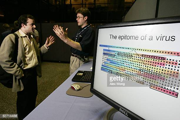 Researcher Nebojsa Jojic of Microsoft Research talks to physicist Steve Sax of the US Patent and Trademark Office as he demonstrates 'Biology and...