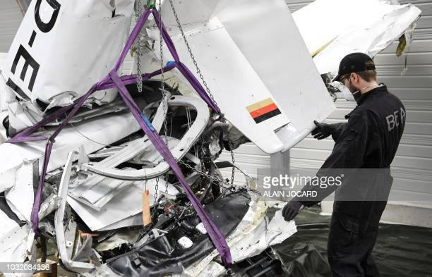 Researcher of the Office of Investigation and Analysis analyses the wreckage of a crashed plane in a shed at the BEA headquarters, on September 11 in...