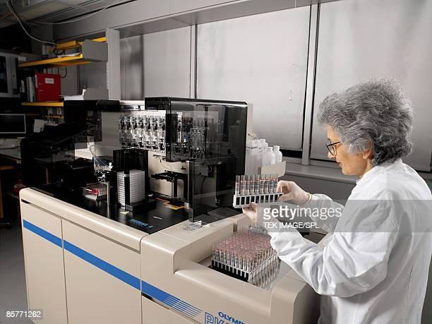 Researcher preparing blood samples