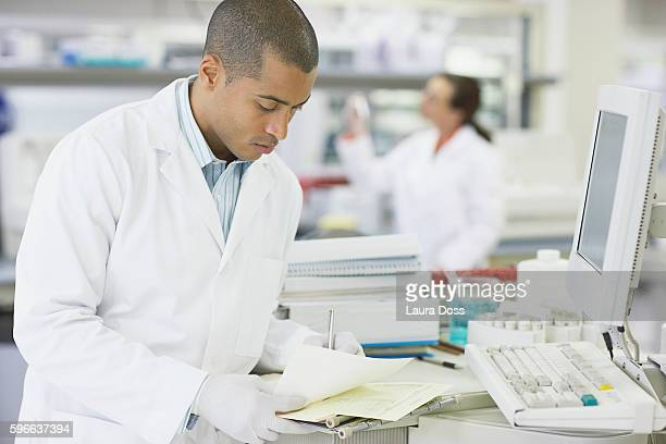 Researcher recording notes
