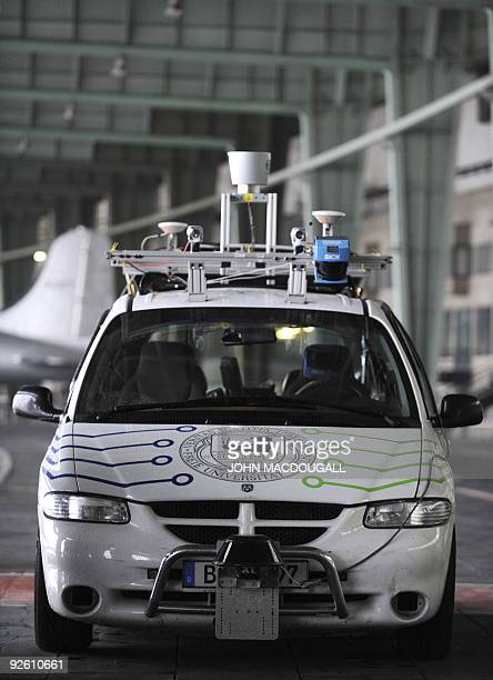 Researcher Tinosch Ganjineh drives the 'Spirit of Berlin' an autonomous car with an iPhone using a wifi connection at Berlin's Templehof airport...