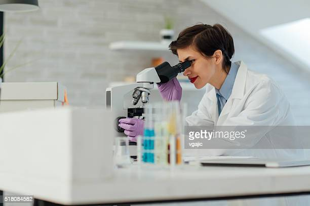 researcher working in her lab. - physicist stock photos and pictures