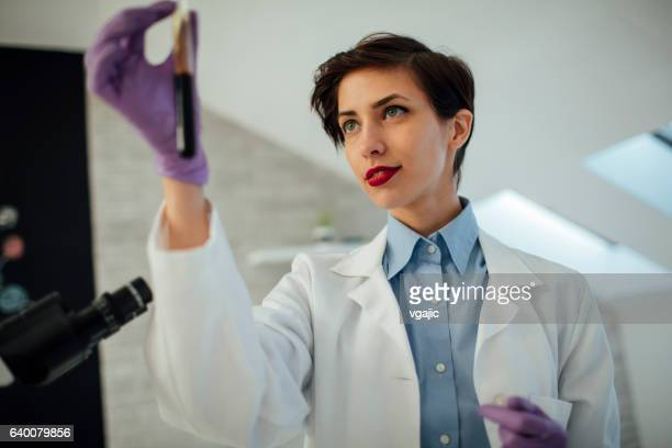 Researcher Working In Her Lab.