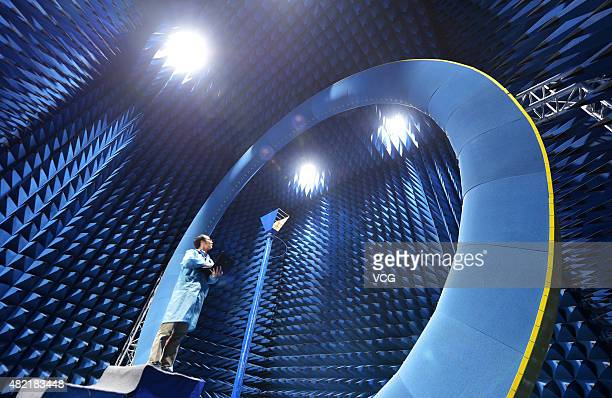 A researcher works at an antenna nearfield test room at FiberHome Technologies Group on July 27 2015 in Wuhan China Wuhanbased FiberHome Technologies...