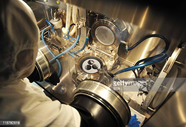 A researcher works at the Wuhan National Laboratory for Optoelectronics in central China's Hubei province on June 9 2011 China has shot to second...