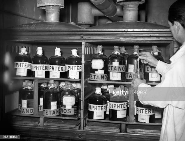 A Researcher works in the tetanus and diphteria research laboratory of the Pasteur Institute 06 November 1938 in Garches The Pasteur Institute was...