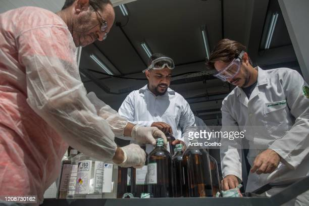 Researchers and students of the Rio de Janeiro Federal University work in the production and packaging of alcohol 70% to help public hospitals during...