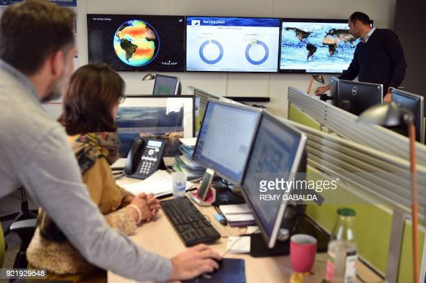 Researchers at the analysis centre of Mercator Oceans look at screen images of ocean surveillance on December 7 2017 in Toulouse What is the...