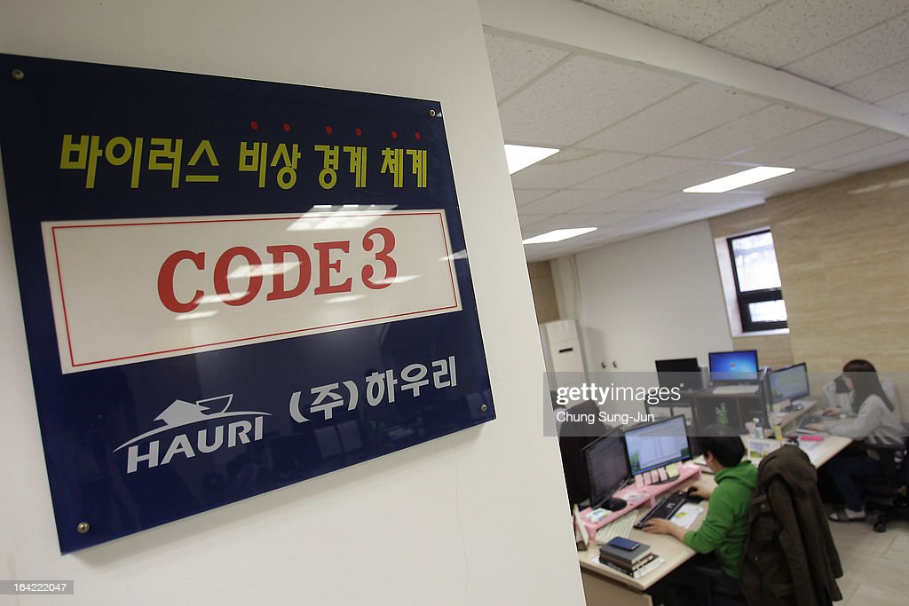 Researchers inspecting for computer viruses at Hauri Inc. the IT security software vendor on March 21, 2013 in Seoul, South Korea. A cyber attack on the computer networks that run three South Korean banks, two broadcasters and an internet service provider in South Korea yesterday has been traced to an IP address in China, despite many experts suspecting the attacks to originate in North Korea. Officials noted that while the attack was traced to an IP address it China may have originated elsewhere and been routed through the country to disguise the attackers.