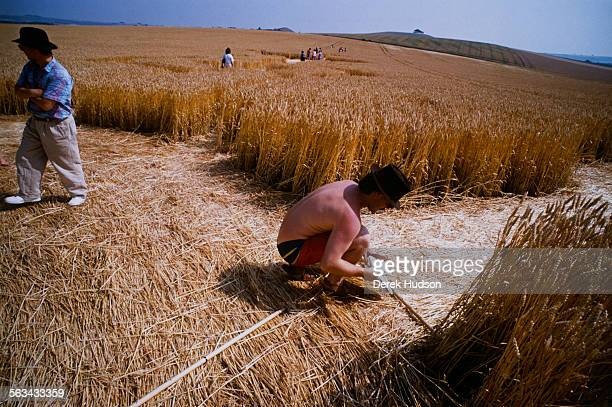 Researchers measuring crop circles in a field near Winchester UK 1990