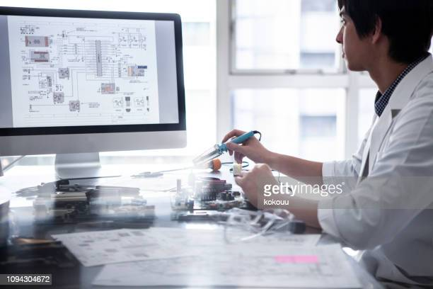 researchers who confirms the design drawing on a personal computer. - electronics stock pictures, royalty-free photos & images
