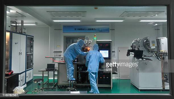 Researchers work at the Wuhan National Laboratory for Optoelectronics in central China's Hubei province on June 9 2011 China has shot to second place...