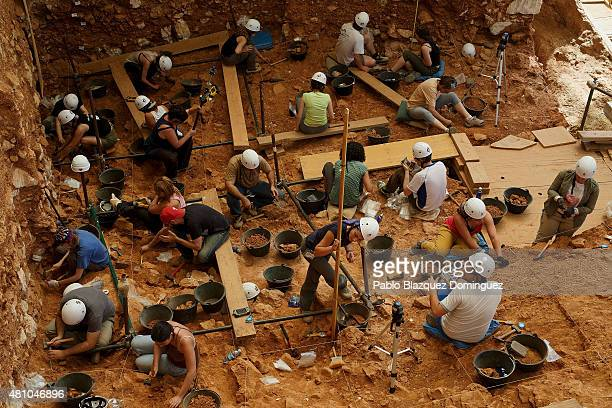 Researchers work on the archeological site in Atapuerca Mountains on July 16 2015 near Ibeas de Juarros in Burgos province Spain Atapuerca Mountains'...