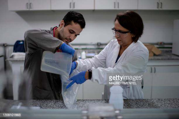 Researchers work on the development of alcohol gel for public hospitals at the laboratories of the Federal University of Rio de Janeiro in Rio de...