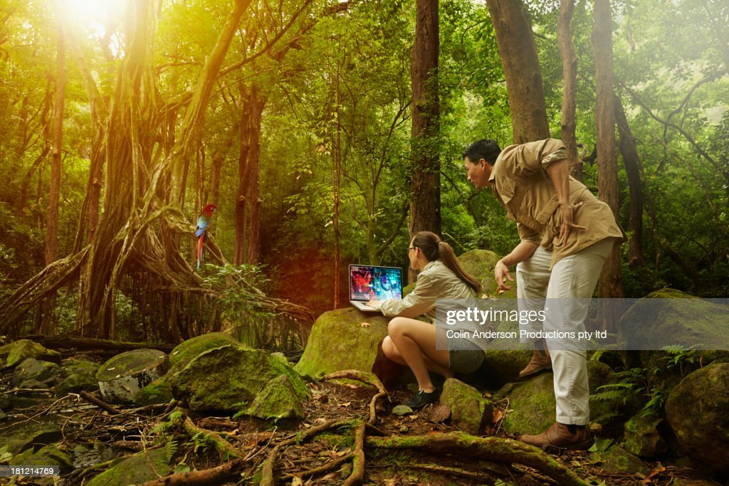 Researchers working in jungle : Stock Photo