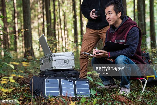 Researchers working together at a remote solar powered field laboratory