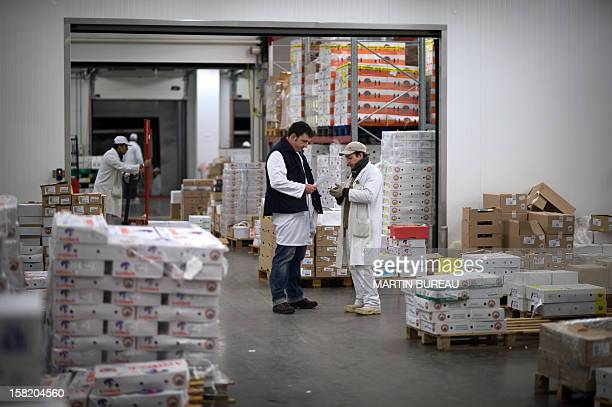 A reseller negociates at the poultry department of the international food market of Rungis on December 11 2012 AFP PHOTO MARTIN BUREAU
