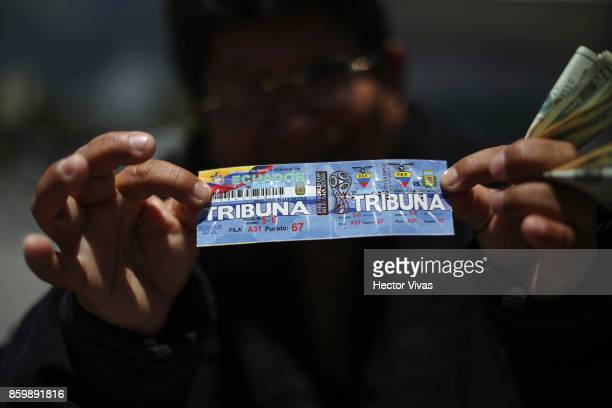 Reseller shows a ticket prior a match between Ecuador and Argentina as part of FIFA 2018 World Cup Qualifiers at Olimpico Atahualpa Stadium on...