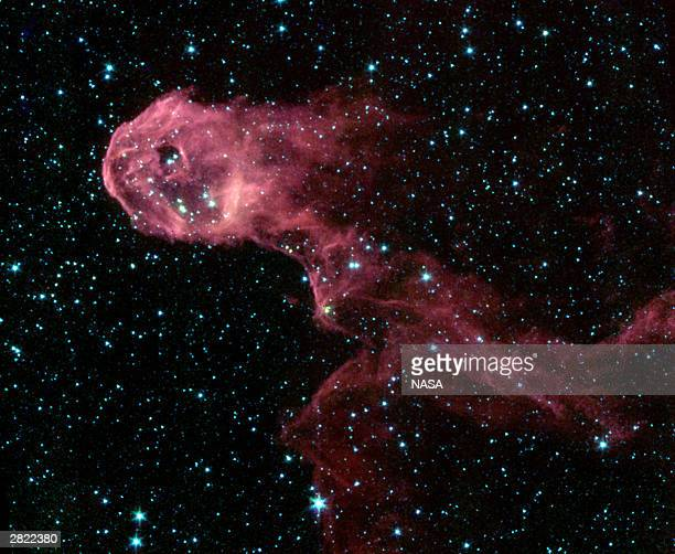 Resembling a flaming creature on the run this image exposes the hidden interior of a dark and dusty cloud in the emission Nebula IC 1396 Young stars...