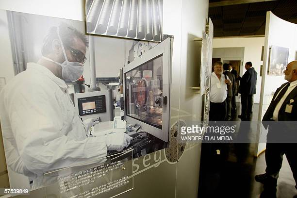 Brazilian authorities and guests visit an exposition with photographs of the uranium enrichment process at the Industria Nuclear del Brasil in...