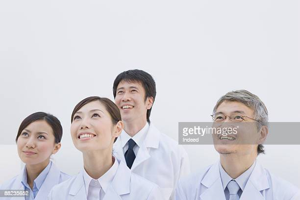 Reserch scientists looking up