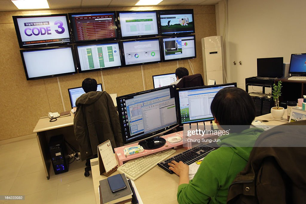 Reserchers inspecting for computer viruses at Hauri Inc. the IT security software vendor on March 21, 2013 in Seoul, South Korea. A cyber attack on the computer networks that run three South Korean banks, two broadcasters and an internet service provider in South Korea yesterday has been traced to an IP address in China, despite many experts suspecting the attacks to originate in North Korea. Officials noted that while the attack was traced to an IP address it China may have originated elsewhere and been routed through the country to disguise the attackers.